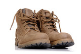 Pair of leather trekking shoes isolated on white background poster