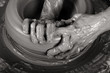 Close-up picture of a potter works a potter's wheel