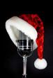 Santa hat sitting on vintage microphone over black