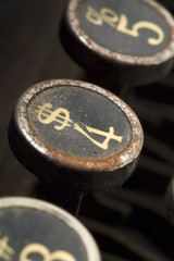 a dollar symbol on a typewriter key