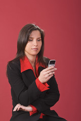 Young brunette checking her mobile phone.