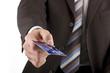 Businessman handing over credit card