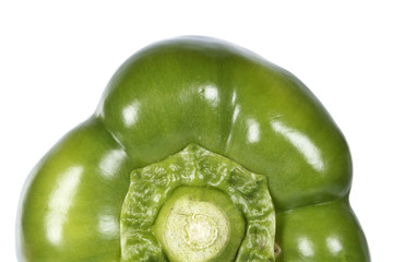 Fresh green pepper reflected on white background. Shallow DOF