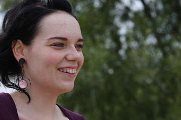 Young brunette smiling  with plenty of copy-space