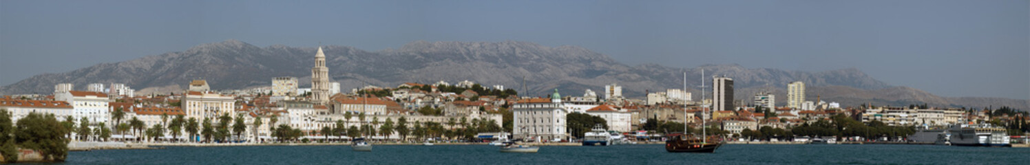 Split waterfront with the moutains in the background.
