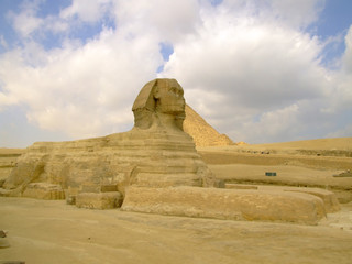 The sphinx of giza with the pyramids in the background