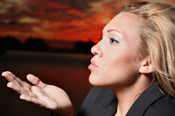 Young female blowing a kiss