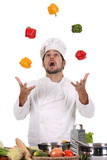 Fototapety funny chef juggling with peppers in colors
