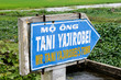 Sign in in Vietnam pointing to tomb of Tani Yajirobei.