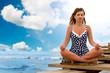 Young woman in pose lotus meditating