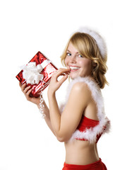 Beautiful Santa girl with a red gift