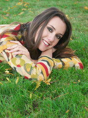 beautiful girl lying on fresh grass outdoors