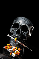 Skull and Pills on Black Background