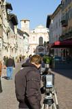 cameraman is shooting a urban scene poster