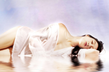 Asian beauty laying down in pool of water