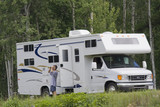 Big Motorhome with owner in the woods, Canada poster