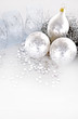 beautiful silver seasonal Christmas decorations on background