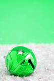 green christmas bell  surrounded by fake snow poster