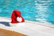 Santa hat near the swimming pool - 10289544