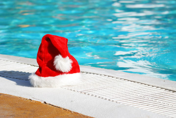 Santa hat near the swimming pool