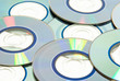 Stock of recordable compact discs on white