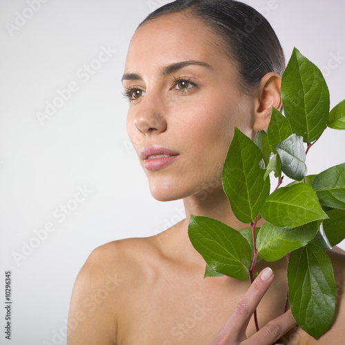 Beautiful woman and plant