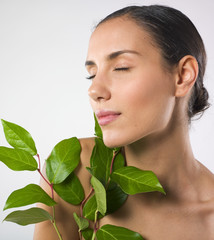 Relaxed woman with plant