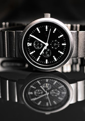 Men's wrist watch on black background. Studio shoot.