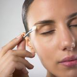 lady applying eyeshadow poster