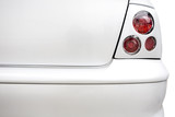 Rear red lights on plain white car. Styling and tuning concept poster
