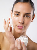 woman applying  lotion. poster