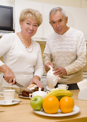 Elderly couple have a breakfast