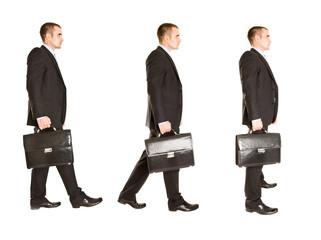 Walking handsome businessman. Hi key