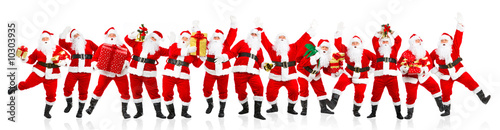 Happy dancing Christmas Santa. Isolated over white background. - 10303935