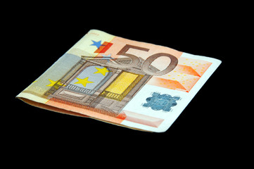 An isolated to black image of a 50 euro note