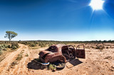 a car rusts away under a hot sun in the desert at silverton