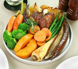 Roast lamb with garlic, broccoli, eggplant, parsnips and onion