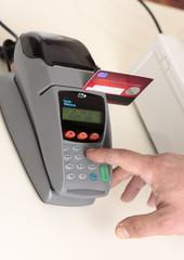 A retailer, salesman or customer using an eft pos machine
