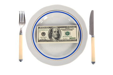 dollars on food plate with fork and knife
