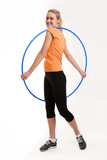 Cheerful girl doing exercises with hoop