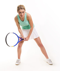 Serious woman with tennis racquet looking straight