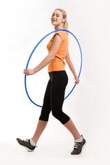 Photo of positive female holding blue hoop