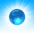 The Planet Earth on abstract blue background
