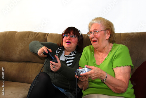 poster of Granddaughter and Grandmother Playing Video Games