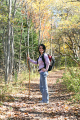 pretty teenage girl hiking outside in the fall