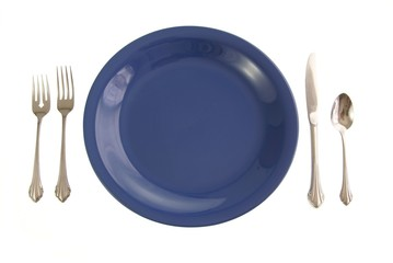 Blue table place setting. Blue plate and silverware on white