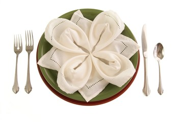 Elegant table setting with plates cloth napkin silverware