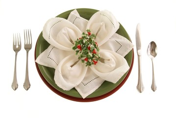 Holiday Table Setting with seasonal greenery