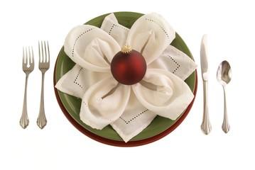 Decorative table setting w plates cloth napkin red ornament