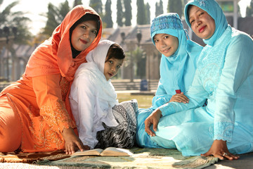 Muslim Mothers and Kids Reading Qur'an